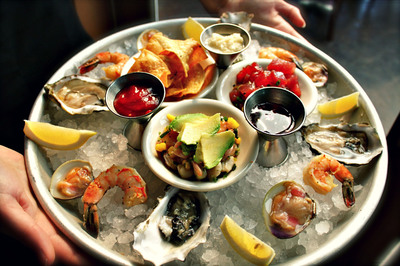 Sam's Chowder House, now in Half Moon Bay and Palo Alto, CA, offers an Oyster Bar featuring Sam's Captain's Platter with raw oysters, clams, chilled shrimp, Ahi Tuna Poke and Seafood Ceviche.  (PRNewsFoto/Sam's Chowder House)
