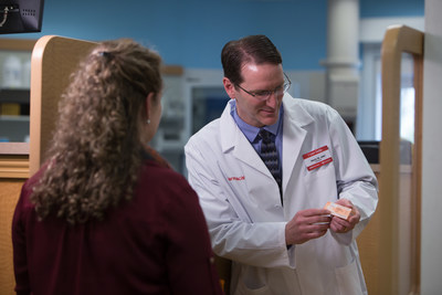 CVS Pharmacist counsels patient about the opioid overdose-reversal drug naloxone