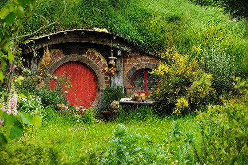 "Crystal's exclusive dinner at the Hobbiton movie set in New Zealand includes visiting ""Hobbit holes"" -- i.e., Hobbit homes build into hills.  (PRNewsFoto/Crystal Cruises)"