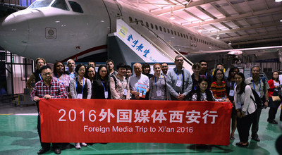 Group photo of the journalists in G-aero, a maintenance and training company in Weibei Industrial Zone, where parts of China's own jet airliner C919 are made.