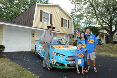 Eckrich and Richard Petty Hand Over Keys for a Mortgage Free House to Illinois Military Family.  (PRNewsFoto/Eckrich)