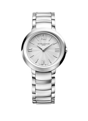 """A steel watch for women, the Promesse 10157 comes with a silver-colored """"drape guilloche"""" dial, a round 30mm steel case, and features a quartz movement. For more information about Baume & Mercier, visit https://www.baume-et-mercier.com"""