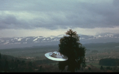 UFO photo by Billy Meier, July 9, 1975, Switzerland. One of nine showing UFO circling the tree. Meier took 1,200 clear, daytime photos on 35 mm film, pre-computer, pre-digital era. Independent, expert analysis showed no models, miniatures or special effects, with real, full-sized tree. Meier took eight films, a video,  sound recordings and presented metal samples for analysis. All of his evidence remains irreproducible. His contacts with the Plejaren extraterrestrials began in 1942...and continue today. Purpose is to help us assure our own future survival. His prophetic information warned of WTC attack, terrorism, wars, Ebola and AIDS epidemics, etc.
