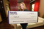 Cathy R. holds a ceremonial check at Harrah's Casino in Atlantic City after winning more than $1.3 million playing a HarrahsCasino.com slot game at her home on November 6.