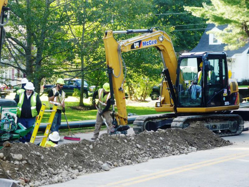 Construction crews from Summit Natural Gas of Maine install a portion of pipeline on Sewall Street in Augusta ...