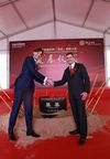 Marc Krauth (l), Global Business Director Interior & Transportation and Brett Simpson, CEO Low & Bonar, shake hands during today's Foundation Ceremony in Changzhou.