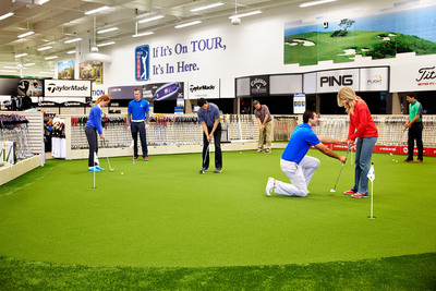 Golfers enjoy the interactive experience at a PGA TOUR Superstore. The mega retailer announced plans to expand and will add one million square feet of new golf retail space over the next five years. The store's average size is 40,000 to 50,000 square feet with up to 14 simulators and a 2000 square foot putting green. Consumers can practice and demo new equipment.  (PRNewsFoto/PGA TOUR Superstore)