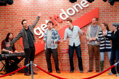 Members of the Upright Citizens Brigade bring collaboration with technology to life in Times Square with Microsoft Office 365 for Microsoft Corp.'s global Get It Done Day on Nov. 7. (Gary He/Insider Images for Microsoft Office 365).  (PRNewsFoto/Microsoft Corp.)