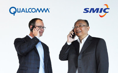 Derek Aberle, president of Qualcomm Incorporated, and Dr. Zixue Zhou, Chairman of SMIC, make a phone call using a Chinese brand Smartphone powered by a Qualcomm Snapdragon processor that has been manufactured from SMIC's 28nm process.
