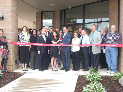 Art Van Executives and South Lyon Chamber Members cut ribbon on 6th Art Van Pure Sleep.  (PRNewsFoto/Art Van Furniture)