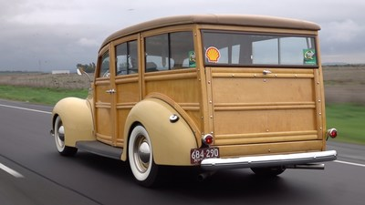 """Tom Cotter hits the road in his 1939 Ford Woodie during his """"The Barn Find Hunter"""" web series."""