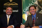 Dr. David Lopez, president of The National Hispanic University (NHU), and Dr. Lawrence Buckley, president of Canada College, sign an agreement Monday, June 17 that creates a partnership between the schools to offer NHU's Bachelor of Arts in Child Development at the Canada College University Center. Classes for the degree begin this fall and will be taught by NHU's award-winning faculty. Early Childhood Education is the largest academic program at Canada College and the partnership with NHU gives students the opportunity to earn a bachelors degree without leaving Canada.  (PRNewsFoto/The National Hispanic University)