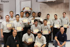 Students from Lincoln Tech's Mahwah campus proudly display their Miele Certificates of Achievement. Also pictured, Lincoln Tech HVAC instructor Damon Degrassie (left) and Miele Installation Trainer Oliver Schmidt (right).