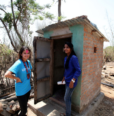 A youth leader from a child club shows UNICEF Ambassador, Selena Gomez a household toilet that was built in Dokrena/Khaira village. Photo Credit: Courtesy of U.S. Fund for UNICEF/Josh Estey/MataHati (PRNewsFoto/U.S. Fund for UNICEF, Josh Estey/MataHati)