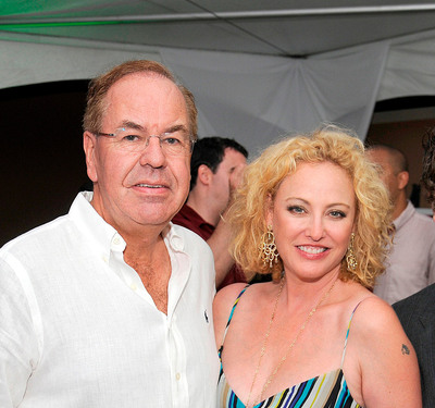 Managing Director of Divi Resorts Aruba and Bonaire Alex Nieuwmeyer with Academy Award and Golden Globe nominated actor Virginia Madsen at the Divi Resorts exclusive Aruba International Film Festival after-party.  (PRNewsFoto/Divi Resorts)