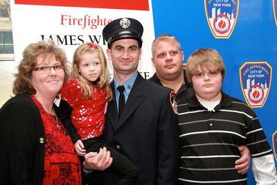 "Firefighter James Wildes, 37, of Engine 162 on Staten Island, with the recipient of his life-saving stem cell donation, six-year-old Alise Mareerose Williams of Evansdale, Iowa, and her family. Both attended the New York Blood Center's ""Honor Roll of Life"" ceremony at FDNY headquarters. PHOTO Credit: Chris Herder, Photography.  (PRNewsFoto/New York Blood Center, Chris Herder)"