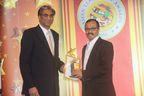 Dr. Vinod Vasudevan, CEO Flytxt, receiving Asia Leadership Award Trophy from Mr. Rahul Kanodia, CEO, Datamatics