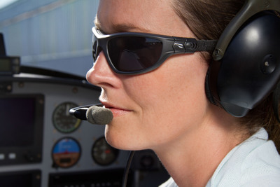 The Flying Eyes' strap system is designed to be worn comfortably with a headset. Unlike all other sunglasses, the strap on Flying Eyes is soft, flat, and unnoticeable between one's head and the headset so there is no pressure or pain, even after a long day of flying.  (PRNewsFoto/Flying Eyes Sunglasses)