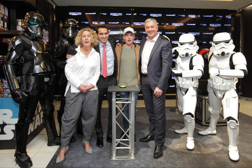 L-R Anna Hill CMO Disney, World Duty Free's CEO, Eugenio Andrades, Jack Maynard, and Gatwick's Chief Executive Stewart Wingate feel the Force as Rogue One: A Star Wars Story lands in Gatwick (PRNewsFoto/World Duty Free)