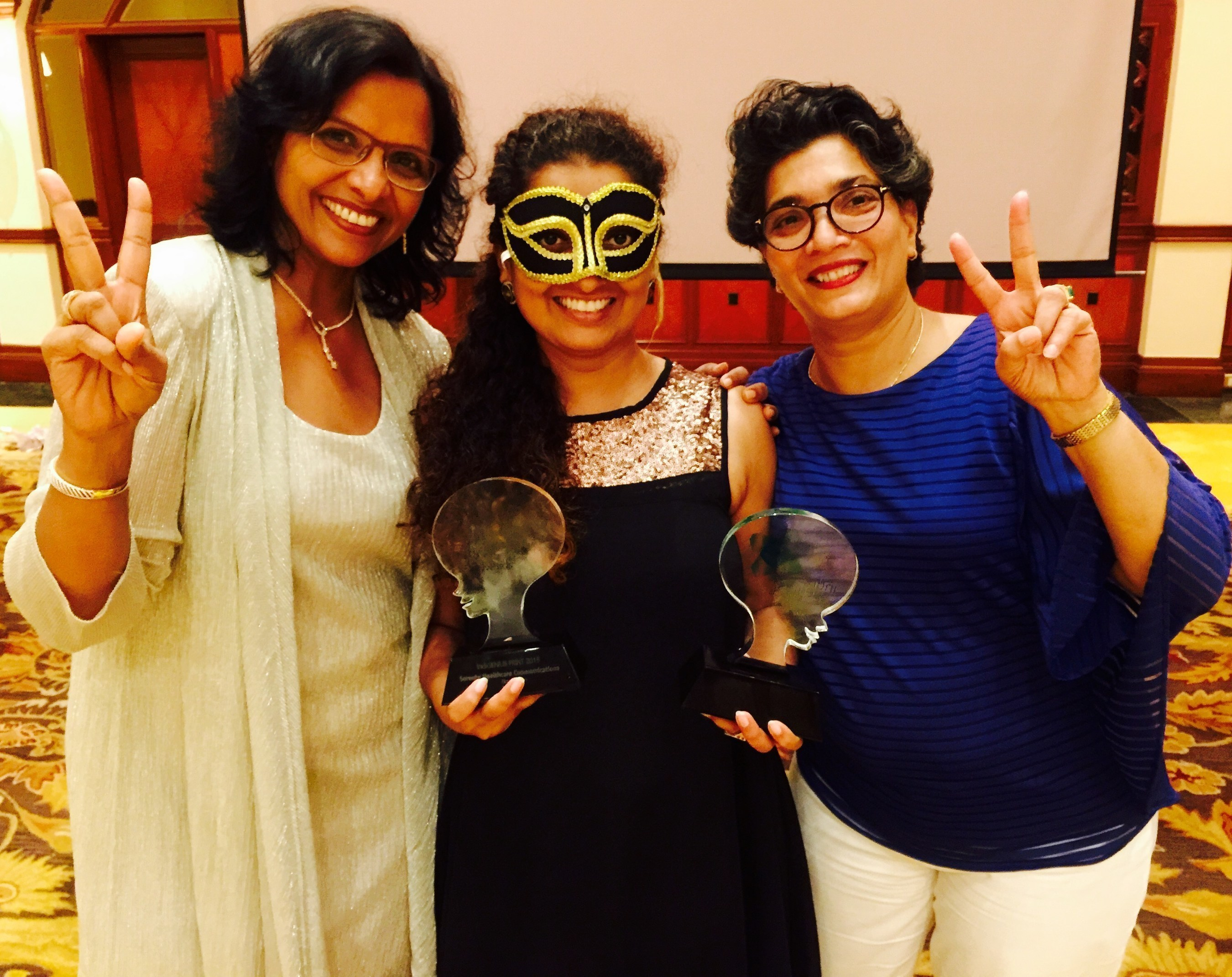 Left to Right: Susan Josi, Ruchi Shah, and Sangeeta Barde of Sorento Healthcare Communications team accept their awards during the 'Secret Society' themed ceremony in Goa, India