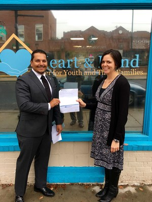 American Income Life State General Agent Richard Correa presents $10,000 to Heart & Hand Center Executive Director Mary Cipollone