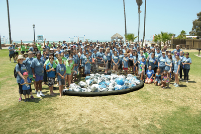 More than 200 employees from Cox Enterprises volunteered for a shore cleanup at Doheny State Beach in Dana Point, Calif. The cleanup took place in partnership with Ocean Conservancy and removed nearly 650 pounds of trash. (PRNewsFoto/Cox Enterprises)
