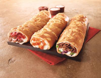 Pizza Hut has launched the P'Zolo, a new take on the sub sandwich in three delicious recipes: Meat Trio, Italian Steak and Buffalo Chicken.  (PRNewsFoto/Pizza Hut)