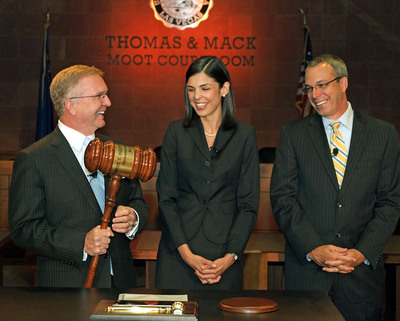 Attorneys Robert Eglet, L, and David Wall, R, pass the gavel to the first Eglet Wall law scholarship recipient Alexandra Varela Thursday, May 24, 2012, during the announcement ceremony for the Robert T. Eglet Advocacy Center in Las Vegas, NV.  University of Nevada, Las Vegas law students will be able to utilize the courtroom which will be a part of the new advocacy center. Construction will begin on the 46,000 sq. ft. Advocacy Center in June 2012 with a completion date of December 2013. (PRNewsFoto/SCM)