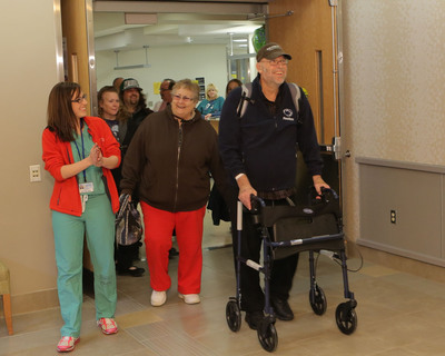 Feb. 4, 2013: SynCardia Total Artificial Heart recipient Bob Phillips, 74, leaves Penn State Hershey Medical Center with his wife Norma to wait for a matching donor heart at home. He is the oldest patient in the U.S. to be discharged from the hospital using the Freedom portable driver to power his Total Artificial Heart. Photo by Darrell Peterson, Penn State Milton S. Hershey Medical Center.  (PRNewsFoto/SynCardia Systems, Inc.)