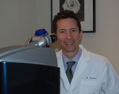 Harry Koster, MD and the WaveLight(R) EX 500 Laser. (PRNewsFoto/NY Vision Group)