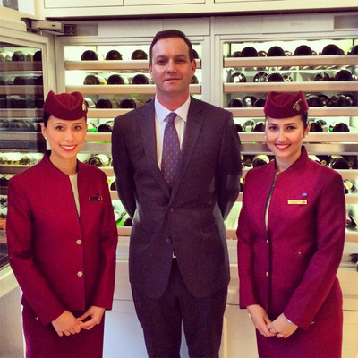Qatar Airways Partners With Wine Spectator For Seventh Annual Chill Event In Chicago. (Pictured: Qatar Airways Cabin Crew And Qatar Airways' Master Of Wine, James Cluer). (PRNewsFoto/Qatar Airways) (PRNewsFoto/QATAR AIRWAYS)