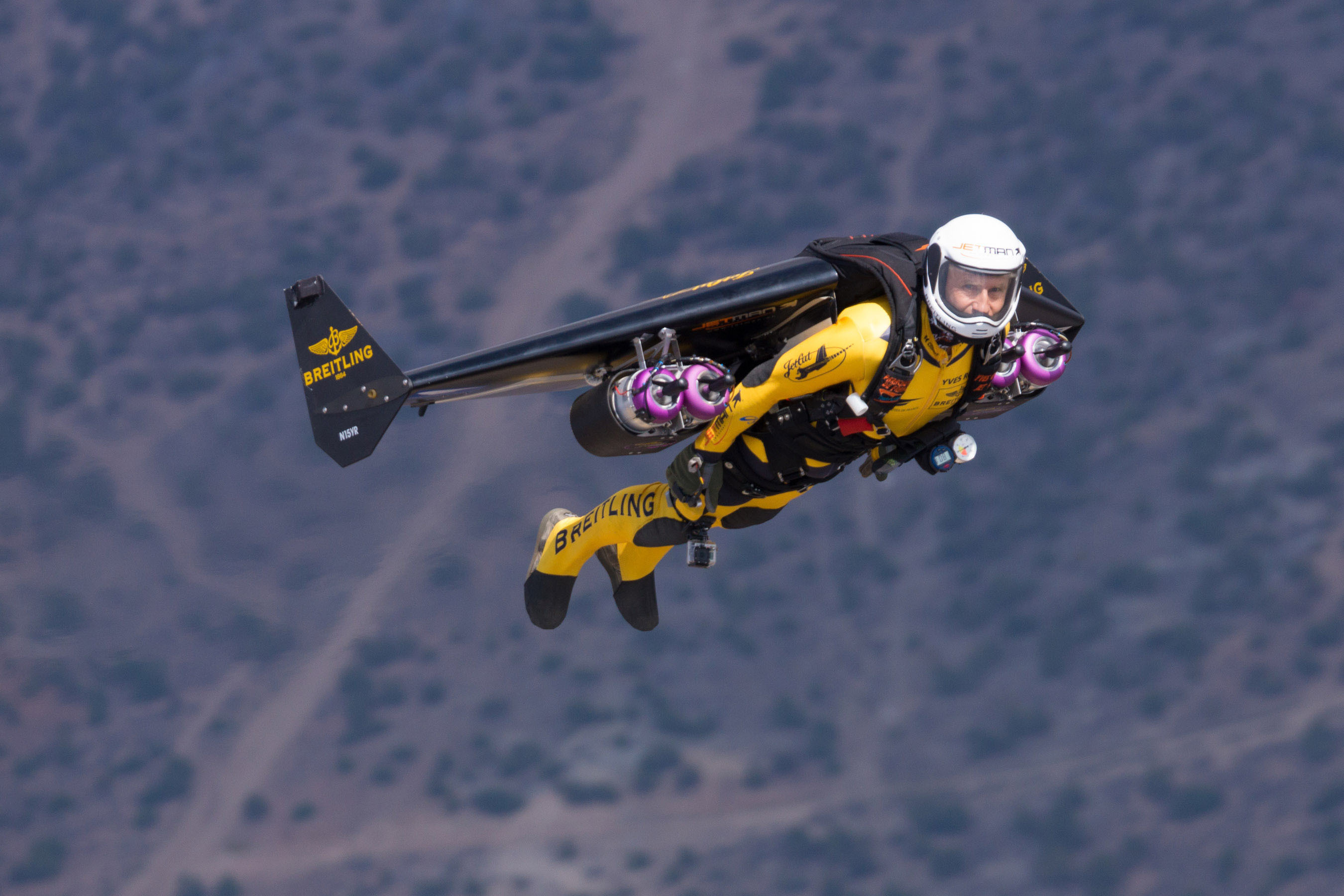"""Yves """"Jetman"""" Rossy flies high above Reno with his Jet Powered wing. Photo by Bernet, courtesy of Breitling SA. (PRNewsFoto/Breitling, Bernet) (PRNewsFoto/BREITLING)"""