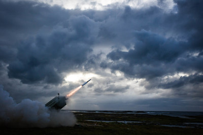 An AMRAAM-Extended Range missile is fired from a NASAMS launcher, successfully engaging and destroying a target drone during a flight test at the Andoya Space Center in Norway.