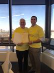Left to right- George Neble, Boston Office Managing Partner of Ernst & Young LLP, and Brian Bielecki, Community Engagement Leader for the EY Boston office holding the mayoral proclamation.