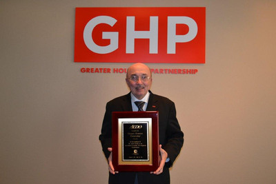 Fred Welch, vice president of economic development for the Greater Houston Partnership, proudly displays AEDO award from the International Economic Development Council. (PRNewsFoto/Greater Houston Partnership) (PRNewsFoto/GREATER HOUSTON PARTNERSHIP)