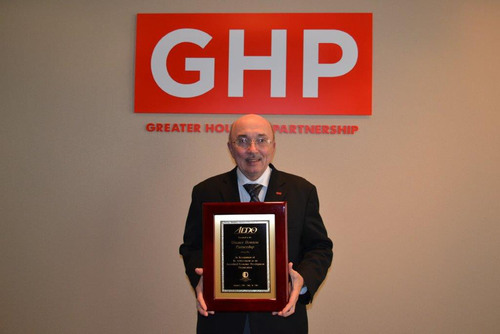 Fred Welch, vice president of economic development for the Greater Houston Partnership, proudly displays AEDO ...