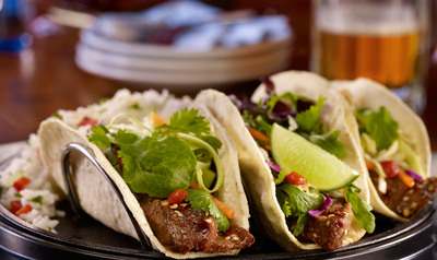 T.G.I. Friday's(R) guests now have 17 more reasons to come in to Friday's and celebrate with the introduction of 17 new menu items, including indulgent dishes that follow current flavor trends, like the Korean Steak Tacos.  (PRNewsFoto/T.G.I. Friday's)