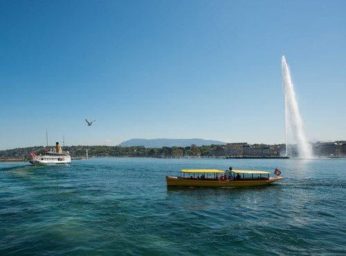 The famous Jet d'Eau, iconic landmark of Lake Geneva offering a peaceful panorama on the city ...