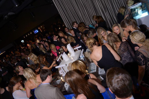 Party goers flock to the Origami Owl's charm-filled booth at the Big Machine Label Group's CMA Awards ...