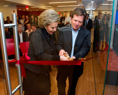 Mrs. Lily Safra and Michael J. Fox cut the ceremonial ribbon to dedicate the Edmond J. Safra Conference Room at The Michael J. Fox Foundation for Parkinson's Research. Photo courtesy of The Michael J. Fox Foundation.  (PRNewsFoto/The Michael J. Fox Foundation)