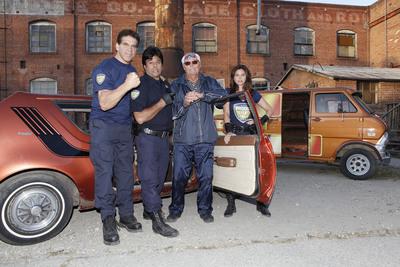 Defenders Lou Ferrigno, Erik Estrada, and Charisma Carpenter reveal Adam West as Butterfinger's Most Wanted BARGLAR.  (PRNewsFoto/Nestle USA)
