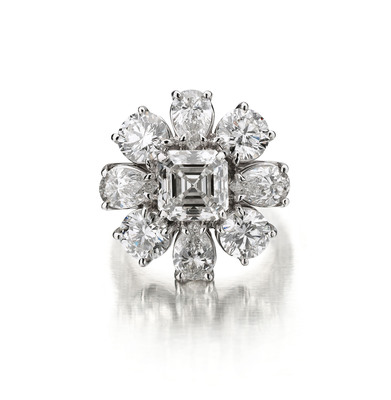 PRINCESS RING #RG45176 - 3.03 Asscher cut center H VS1 with 4 P/S approx. .75ct each and 4rounds .75 ct each with pave shank in platinum.  (PRNewsFoto/Neiman Marcus, Glenn Russen)