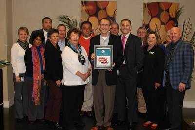 Representatives from Wind Creek Hospitality pictured with award.