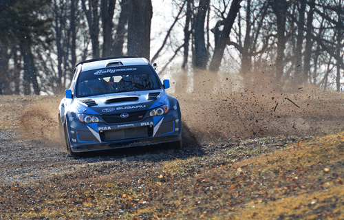 Returning Rally America Champion David Higgins attacking the Ozark roads of Rally in the 100 Acre Wood in his ...