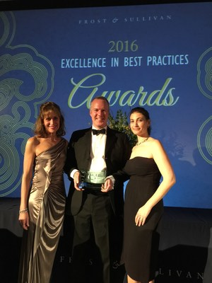 Martin Burns, CEO of BBI, accepting Frost & Sullivan's New Product Innovation Award for the BBI SEM Scanner, with Rachael Lester, BBI's vice president of marketing (right) and Dr. Barbara Bates-Jensen, professor of nursing and medicine at the UCLA School of Nursing and David Geffen School of Medicine (left).