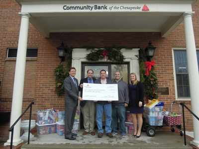 Community Bank of the Chesapeake representatives present a donation to the Southern Maryland Food Bank.