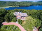 This 7-acre lakefront estate will be sold at a live luxury auction on August 21, 2015 by Platinum Luxury Auctions. The property is located within only 45 minutes of Manhattan, NY. Details at SpringHouseLuxuryAuction.com.