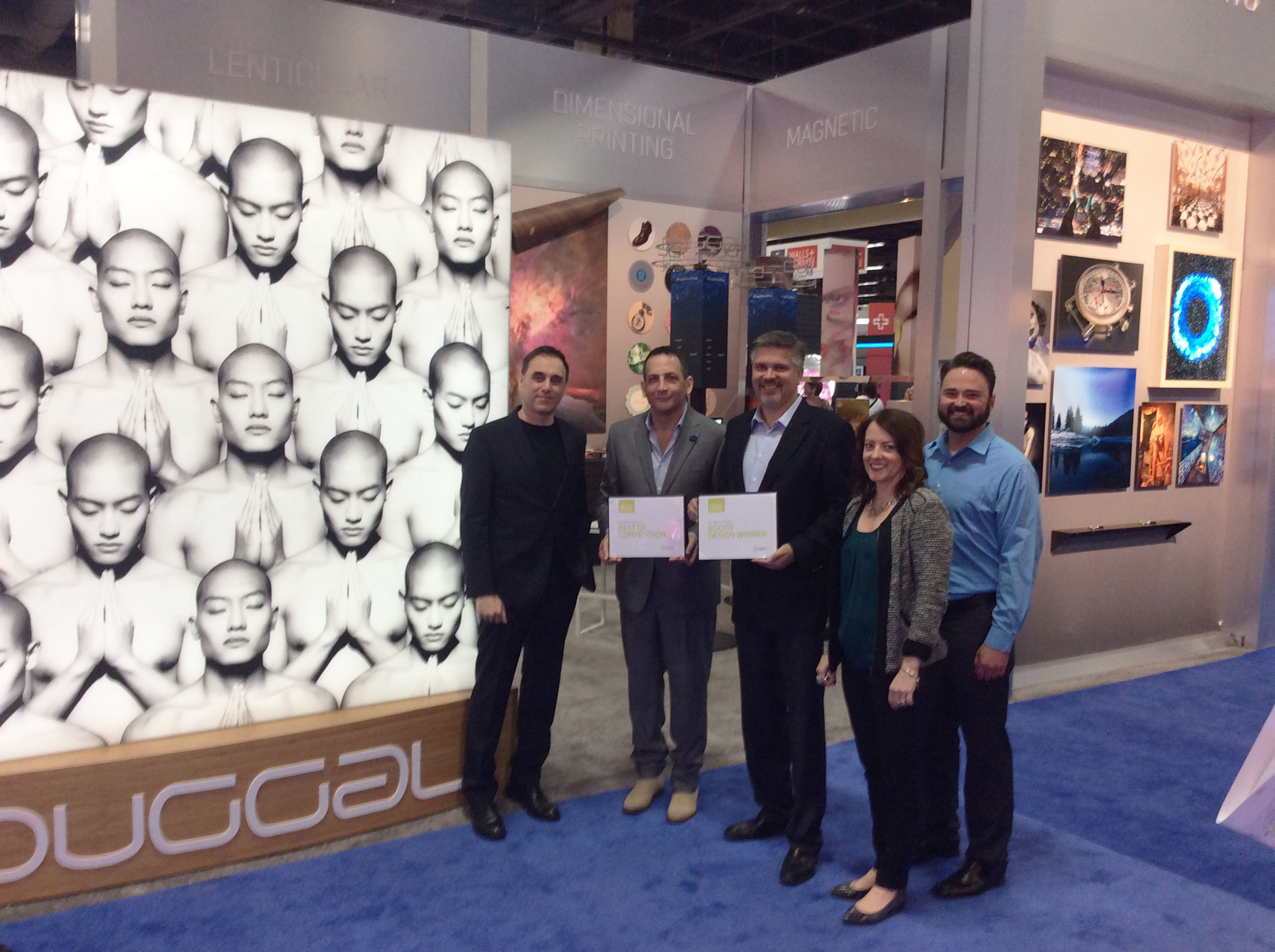 Duggal's Creative Director Glenn Rabbach and CEO Michael Duggal accepting GlobalShop 2016's awards for 'Best of Competition' and 'Best Booth Design'