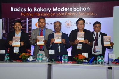 PR NEWSWIRE INDIA- (L-R) Prabodh Halde & Sanjay Indani, Authors of 'Handbook of Regulatory Requirements for Bakery Industry', Uday Annapure, President, Association of Food Scientists and Technologists, India- West Zone, Ramesh Mago, President, All India Bread Manufacturers Association, Milind Dixit Senior Group Director, UBM India- at the Book Launch at Fi&Hi, Mumbai