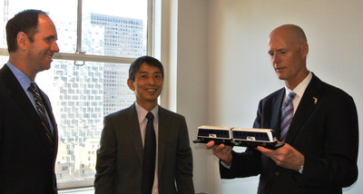 Mitsubishi Presents Governor Scott with a Model Train from the Award Winning MIA Mover Automated People Mover System.  (PRNewsFoto/Mitsubishi Heavy Industries America, Inc.)